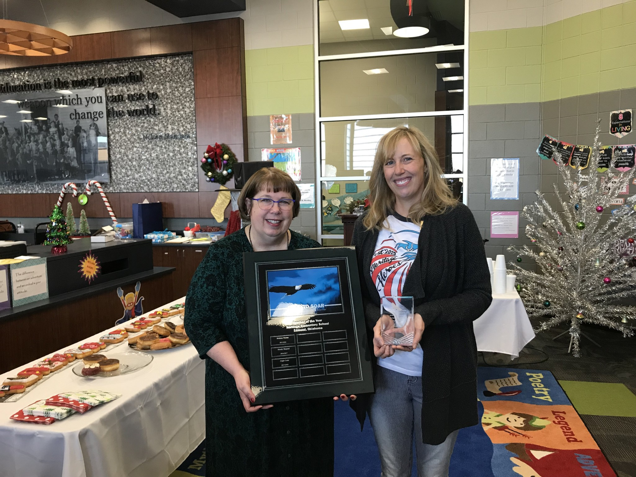 Mrs. Bugg presenting Mrs. Lane with teacher of year award