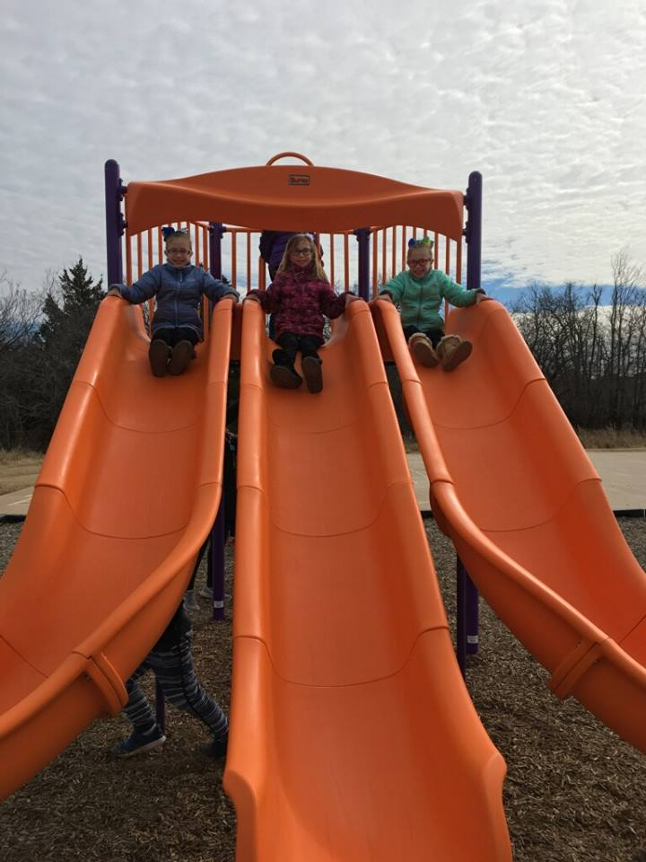 students going down slide