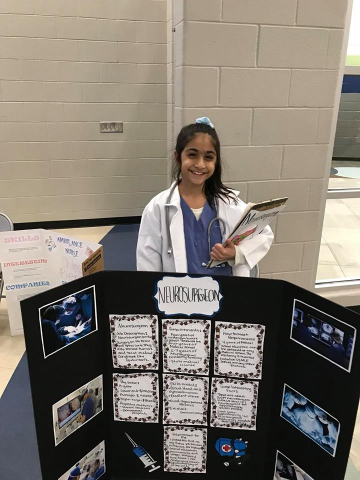 5th grade student with career project presentation