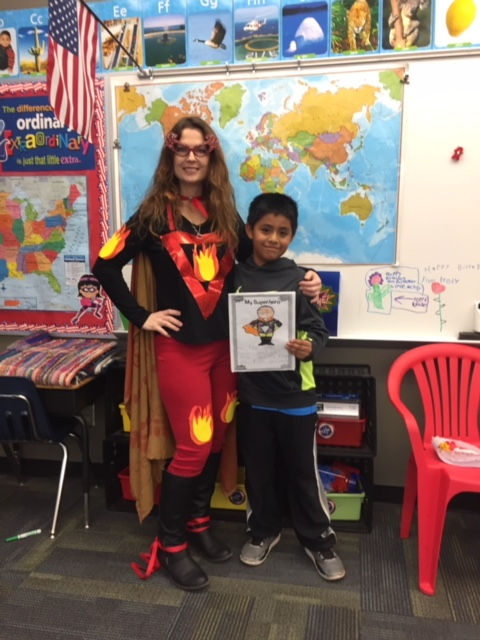 Mrs. Parmer and student dressed as superheroes
