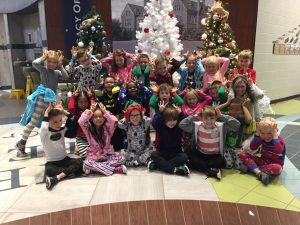 class picture in front of christmas trees