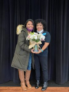 Jane Breckinridge, Support Employee of the Year and her daughter pose with flowers